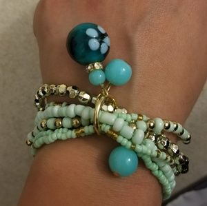 Mint green & gold stretch bracelet with charms